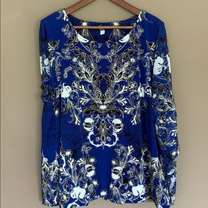Plus size blouse with tie sleeves